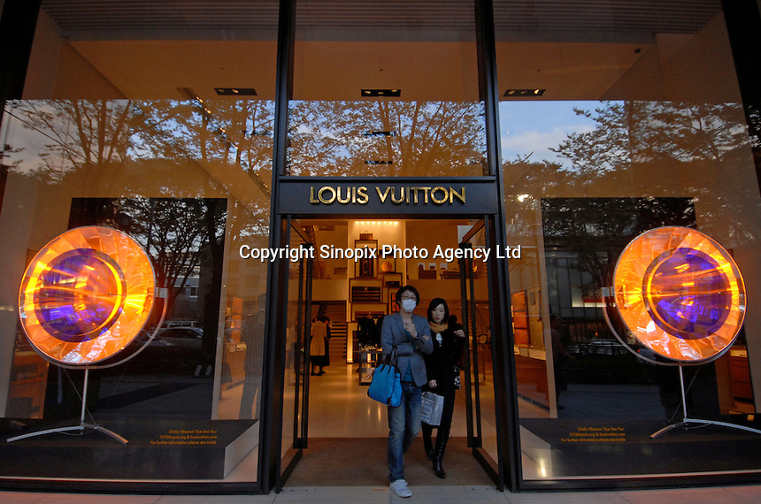 LV's flagship building on Omotesando in Tokyo.  Louis Vuitton.  Japan accounts for a massive ercentage of worldwide sales of LV products (55 % of sales in 2004)..