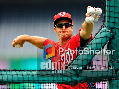 19 June 2011: Washington Nationals' coach and minor league manager Jeff Garber throws batting practice prior to a game between the Baltimore Orioles and the Washington Nationals at Nationals Park in Washington, District of Columbia. The Orioles defeated the Nationals 7-4 in inter-league play, ending Washington's 8-game winning streak. Mandatory Credit: Ed Wolfstein Photo