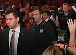 07 June 2006: United States head coach Bruce Arena (USA) (c) is lead through a crowd by his security guard. The United States Men's National Team was honored at City Hall, the Rathaus, in Hamburg, Germany, where the team is based out of for the FIFA 2006 World Cup tournament.