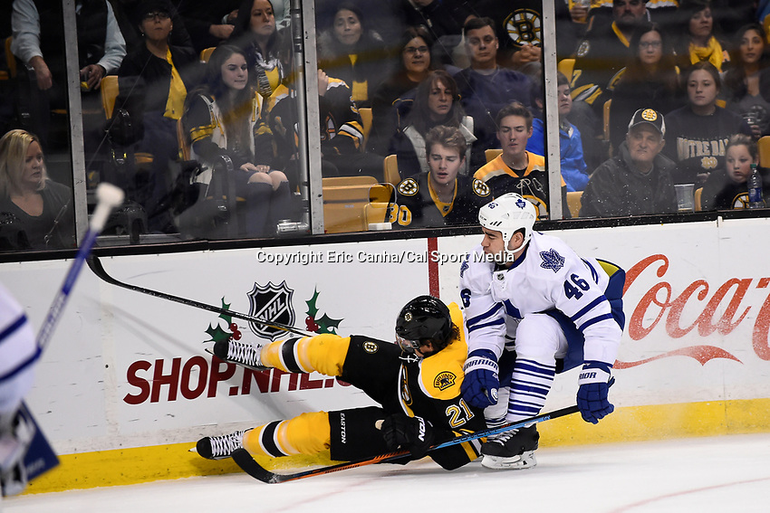 Saturday, November 21, 2015: Boston Bruins left wing Loui Eriksson (21) crashes into the boards with pressure from Toronto Maple Leafs defenseman Roman Polak (46) during the National Hockey League game between the Toronto Maple Leafs and the Boston Bruins held at TD Garden, in Boston, Massachusetts.  Eric Canha/CSM