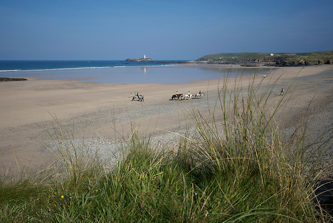 Horse riding at Gwithian sands, West Cornwall