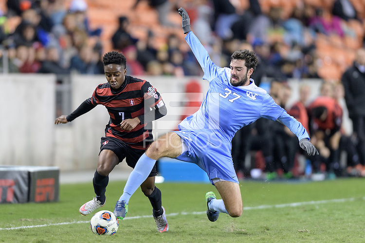 Houston, TX - Friday December 9, 2016: Walker Hume (37) of the North Carolina Tar Heels tries to strip the ball from Bryce Marion (7) of the Stanford Cardinal  at the NCAA Men's Soccer Semifinals at BBVA Compass Stadium in Houston Texas.