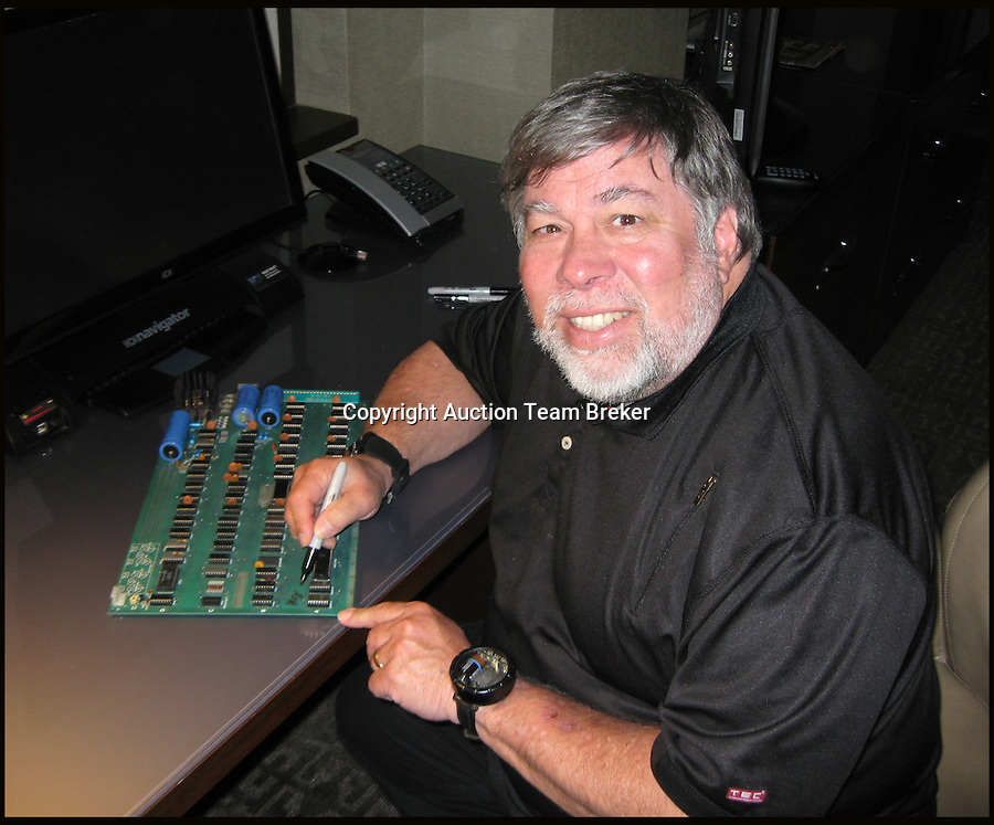 """BNPS.co.uk (01202 558833)<br /> Pic: ATBreker/BNPS<br /> <br /> Steve Wozniak signs the keyboard...<br /> <br /> Humble beginnings of a billion pound business.<br /> <br /> An incredibly rare Apple 1 computer, the 46th ever built and one of just a handful of Apple 1's in existence.<br /> <br /> Dubbed the """"world's best"""" Apple 1, it has been put up for sale for £500,000.<br /> <br /> Included in the sale is a picture of the early production line in Steve Job's bedroom dating from 1976."""