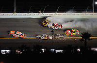 Feb 07, 2009; Daytona Beach, FL, USA; NASCAR Sprint Cup Series drivers Joey Logano (20) Scott Speed (82) David Ragan (6) Robby Gordon (7) and Casey Mears (07) crash as Jeff Gordon (24) slows to avoid during the Bud Shootout at Daytona International Speedway. Mandatory Credit: Mark J. Rebilas-