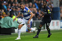 Angel Rangel of Queens Park Rangers and Florian Jozefzoon of Derby County during Queens Park Rangers vs Derby County, Sky Bet EFL Championship Football at Loftus Road Stadium on 6th October 2018