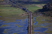 Coaster, commuter train, San Diego County, California, crossing, Los Penasquitos Creek,creek, bridge, Torrey Pines State Beach,Penasquitos Lagoon, lagoon, rail,railroad,railway,rr,train,station,track,tracks,transport,transportation,travel, conservation,ecology,ecosystem,environment,environmental,habitat,landscape,tidal,marsh,marshland,park,refuge,sanctuary,wetland, wetlands, above; aerial photograph; aerialarchives; aerial; aerials; air; elevated; from; Herb Lingl; high; image; over; overhead; overlooking; overview; photography views; America; American; California; Californian; CA; west; western; United States; US; USA, AHLE0692