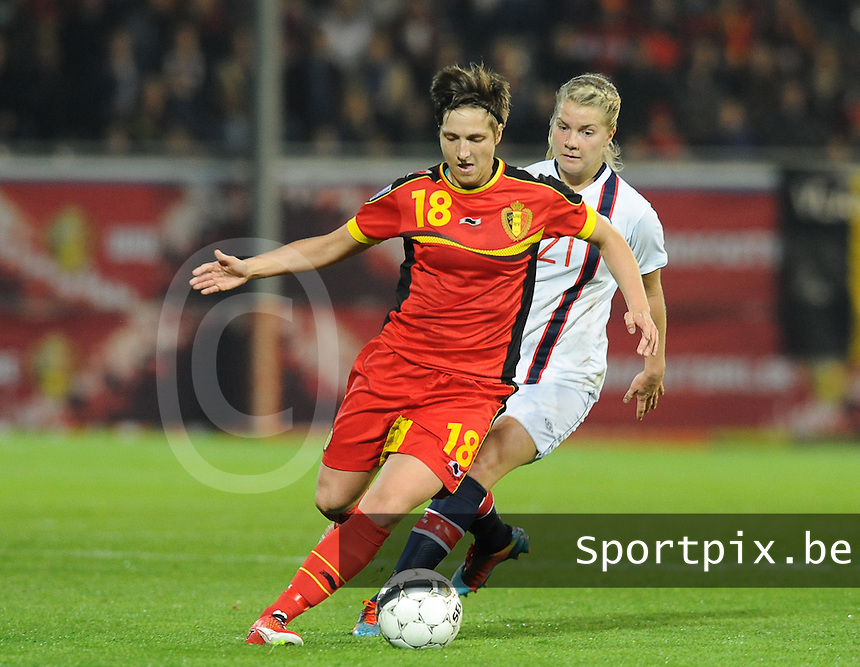 20140410 - LEUVEN , BELGIUM : Belgian Maud Coutereels (18) pictured with Norwegian Ada Hegerberg (21) during the female soccer match between Belgium and Norway, on the seventh matchday in group 5 of the UEFA qualifying round to the FIFA Women World Cup in Canada 2015 at Stadion Den Dreef , Leuven . Thursday 10th April 2014 . PHOTO DIRK VUYLSTEKE