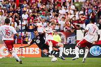 Hamdi Salihi (9) of DC United and Dax McCarty (11) of the New York Red Bulls. The New York Red Bulls defeated DC United 3-2 during a Major League Soccer (MLS) match at Red Bull Arena in Harrison, NJ, on June 24, 2012.