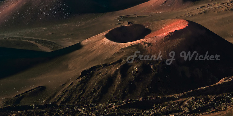 Beautiful warm light highlights a cinder cone in the crater of Haleakala National Park on Maui in Hawaii