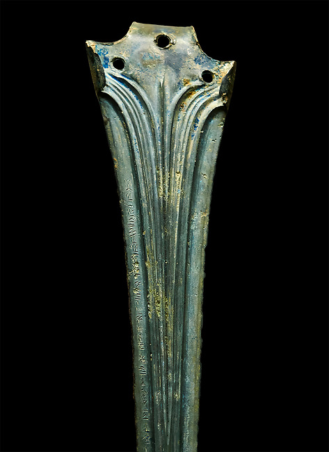 Hittite bronze decorated sword blade close up with writing. Hittite Period 1650 - 1450 BC.  Hattusa Boğazkale. Çorum Archaeological Museum, Corum, Turkey. Against a black bacground.