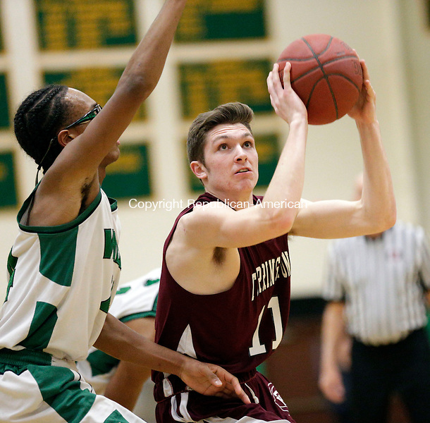 Waterbury, CT- 27 January 2017-012717CM12-  Torrington's Jordan Henneberry looks to the hoop as he's guarded by Wilby's Nasir Smith during their NVL basketball matchup on Friday.   Christopher Massa Republican-American