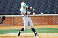Andrew Dundon (14) of the Marshall Thundering Herd makes contact with the baseball against the Wake Forest Demon Deacons at Wake Forest Baseball Park on February 17, 2014 in Winston-Salem, North Carolina.  The Demon Deacons defeated the Thundering Herd 4-3.  (Brian Westerholt/Four Seam Images)