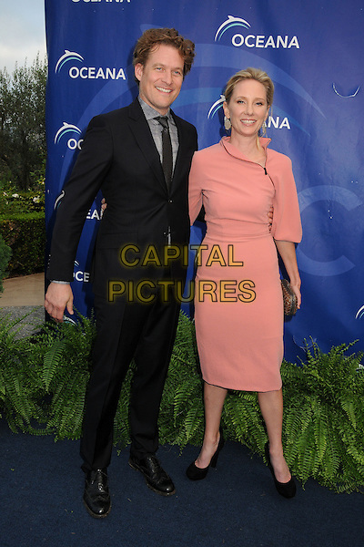 James Tupper, Anne Heche<br /> 6th Annual Oceana SeaChange Gala held at a Private Villa, Laguna Beach, California, USA. <br /> August 18th, 2013<br /> full length pink dress clutch bag gold black shoes suit couple <br /> CAP/ADM/BP<br /> &copy;Byron Purvis/AdMedia/Capital Pictures