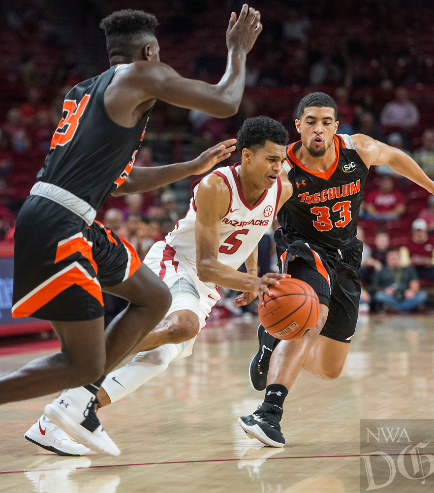 NWA Democrat-Gazette/BEN GOFF @NWABENGOFF <br /> Jalen Harris (5) of Arkansas splits Adrian Cohen (left) and Trenton Gibson of Tusculum in the first half Friday, Oct. 26, 2018, during an exhibition game in Bud Walton Arena in Fayetteville.