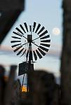 Fairbank-Morse Eclipse steel windmill, full moon rising in winter, Toyabe Range, Nevada