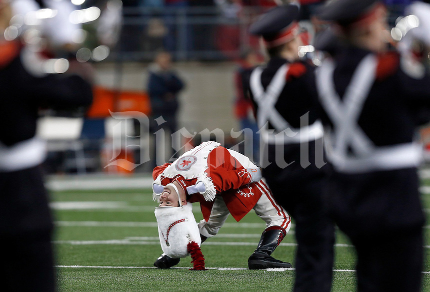 Ohio State drum major touches his cap to the turf prior to the NCAA football game at Ohio Stadium on Saturday, November 1, 2014. (Columbus Dispatch photo by Jonathan Quilter)