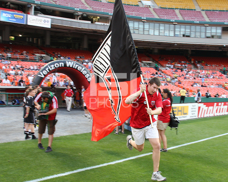 Banner bearer enters the field of D.C. United during an MLS match against Chivas USA at RFK Stadium, on May 29 2010 in Washington DC. United won 3-2.
