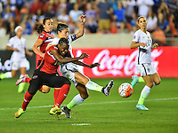 Houston, TX. - February 19, 2016: The U.S. Women's National team go up 1-0 over Trinidad & Tobago during first half action in CONCACAF Women's Olympic Qualifying at BBVA Compass Stadium.