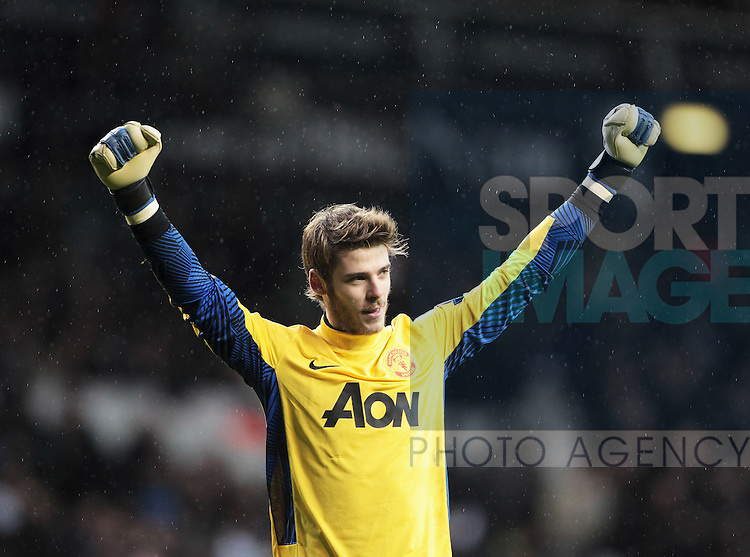 David De Gea of Manchester United celebrates Ashley Youngs second goal during the Barclays Premiership Game between Tottenham Hotspur and Manchester United,at White Hart Lane in London..26th February, 2012.