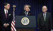 United States President George W. Bush makes a statement after meeting with Members of the Commission on the Intelligence Capabilities of the United States Regarding Weapons of Mass Destruction in the Cabinet Room at the White House in Washington, D.C. on March 31, 2005. In his remarks, the President also expressed sorrow at the death of Terri Schaivo. From left to right: former United States Senator Chuck Robb (Democrat of Virginia), Co-Chairman; President Bush; Judge Laurence Silberman, Co-Chairman.<br /> Credit: Ron Sachs - CNP