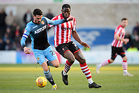 Stevenage's Ron Henry under pressure from Lincoln City's John Akinde<br /> <br /> Photographer Chris Vaughan/CameraSport<br /> <br /> The EFL Sky Bet League Two - Lincoln City v Stevenage - Saturday 16th February 2019 - Sincil Bank - Lincoln<br /> <br /> World Copyright © 2019 CameraSport. All rights reserved. 43 Linden Ave. Countesthorpe. Leicester. England. LE8 5PG - Tel: +44 (0) 116 277 4147 - admin@camerasport.com - www.camerasport.com