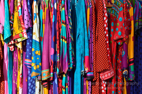Indian sari dresses on display outside a shop.