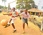 Children playing soccer in Likoni, Kenya.