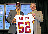 Linebacker Rocky McIntosh (52) from Miami, left, the Washington Redskins first pick in the 2006 NFL Draft, taken in the second round, holds his new jersey with head coach Joe Gibbs, right, during an introductory press conference at Redskin Park in Ashburn, Virginia  on May 1, 2006. <br /> Credit: Arnie Sachs / CNP