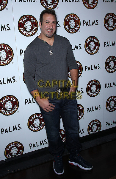 Joey Fatone.Earl of Sandwich Grand Opening Celebration with Holly Madison at The Palms Casino Resort,  Las Vegas, Nevada, USA..July 2nd, 2012.full length grey gray top jeans denim .CAP/ADM/MJT.© MJT/AdMedia/Capital Pictures.