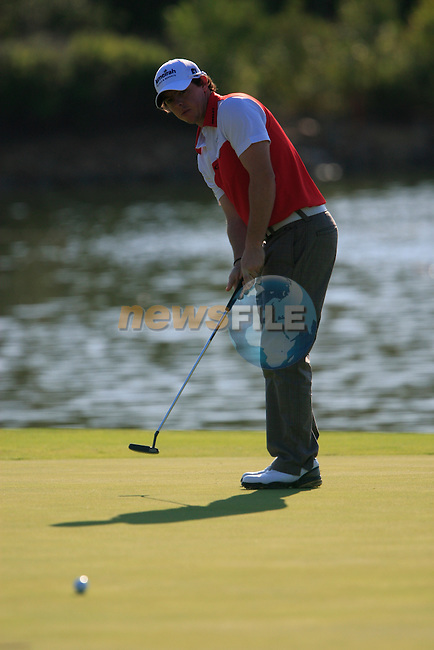 Rory McIlroy (N.IRL) putts on the 4th green during the morning session on Day 3 of the Volvo World Match Play Championship in Finca Cortesin, Casares, Spain, 21st May 2011. (Photo Eoin Clarke/Golffile 2011)