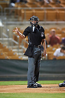 Umpire Travis Eggert makes a call during an Arizona Fall League game between the Salt River Rafters and Glendale Desert Dogs on October 19, 2016 at Camelback Ranch in Glendale, Arizona.  Salt River defeated Glendale 4-2.  (Mike Janes/Four Seam Images)