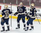 Jeff Costello (ND - 11), Peter Schneider (ND - 15) and Stephen Johns (ND - 28) celebrate a goal. - The visiting University of Notre Dame Fighting Irish defeated the Boston College Eagles 7-2 on Friday, March 14, 2014, in the first game of their Hockey East quarterfinals matchup at Kelley Rink in Conte Forum in Chestnut Hill, Massachusetts.