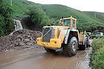 28-7-2013: Locals are calling it a miracle that nobody was hurt when a massive mudslide poured onto the famous Ring of Kerry road between Glenbeigh and Kells completely  blocking passage.  The roadway was very busy at the time and Kerry County Council spennt hours clearing the mud and debris from the road. It als caused chaos for travellers to South Kerry as they had to detour through Ballaghisteen which is fit for only light traffic.<br /> Picture by Don MacMonagle