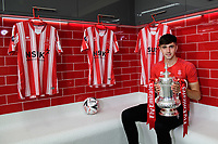 Lincoln City's Ellis Chapman poses for a photograph in the changing rooms at Lincoln City new Elite Performance Centre with the Emirates FA Cup<br /> <br /> Photographer Chris Vaughan/CameraSport<br /> <br /> The official opening of Lincoln City's new Elite Performance Centre - Wednesday 7th November 2018 - Scampton, Lincolnshire<br /> <br /> World Copyright © 2018 CameraSport. All rights reserved. 43 Linden Ave. Countesthorpe. Leicester. England. LE8 5PG - Tel: +44 (0) 116 277 4147 - admin@camerasport.com - www.camerasport.com