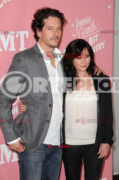 Shannen Doherty and Kurt Iswarienko at Jennie Garth's 40th birthday celebration and premiere party for 'Jennie Garth: A Little Bit Country' at The London Hotel on April 19, 2012 in West Hollywood, California Credit: mpi35/MediaPunch Inc.