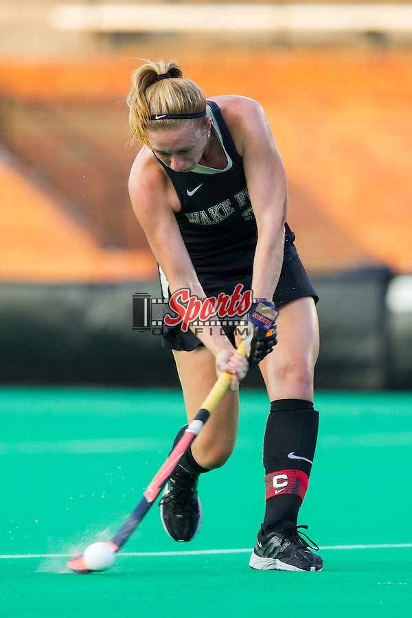 Georgia Holland (9) of the Wake Forest Demon Deacons passes the ball during first half action against the Northwestern Wildcats at Kentner Stadium on September 11, 2014 in Winston-Salem, North Carolina.  The Demon Deacons defeated the Wildcats 1-0.  (Brian Westerholt / Sports On Film)