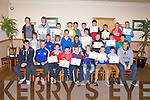 AWARDS NIGHT: Kerry's John Barry Keane and Kerry's minors Martin Tiernay and Jack Savage with the Kerins O'Rahiilys U12 players at the their awards night at the Strand Road clubhouse, Tralee on Friday.