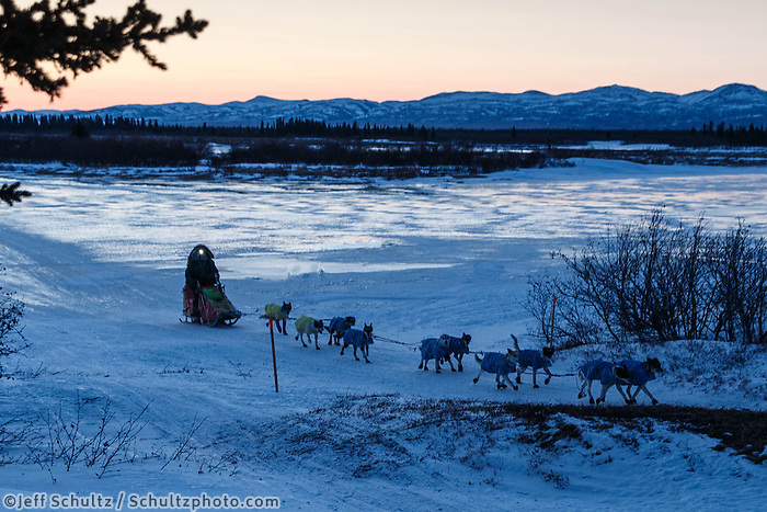 Wade Marrs on the Unalakleet River at dawn on the way into Unalakleet on Sunday, March 9, during the Iditarod Sled Dog Race 2014.<br /> <br /> PHOTO (c) BY JEFF SCHULTZ/IditarodPhotos.com -- REPRODUCTION PROHIBITED WITHOUT PERMISSION