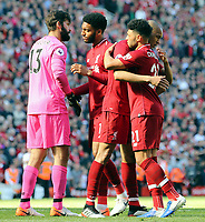 Liverpool players (from left) Alisson Becker, Joe Gomez, Fabinho and Alex Oxlade-Chamberlain console each other as they are left dejected at the final whistle<br /> <br /> Photographer Rich Linley/CameraSport<br /> <br /> The Premier League - Liverpool v Wolverhampton Wanderers - Sunday 12th May 2019 - Anfield - Liverpool<br /> <br /> World Copyright © 2019 CameraSport. All rights reserved. 43 Linden Ave. Countesthorpe. Leicester. England. LE8 5PG - Tel: +44 (0) 116 277 4147 - admin@camerasport.com - www.camerasport.com