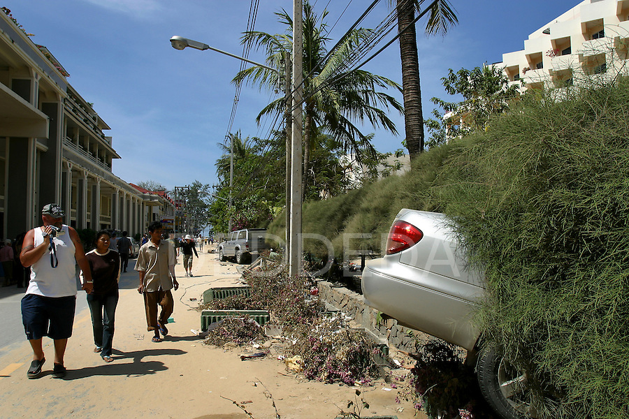 Debris lines the streets after vehicles and various objects were swept away with the tidal wave that hit Patong Beach on Phuket Island, Thailand..On December 26, 2004, a major earthquake generated tsunamis that ravaged coastlines from Southeast Asia to Africa. Approximately 275,000 people were killed and tens of thousands were left homeless, making it one of the deadliest natural disasters in modern history.