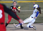 Western Nevada College's Katilyn Covione slides into second against Colorado Northwestern Community College's Amanda Cook at Edmonds Sports Complex in Carson City,Nev., on Friday, Feb. 21, 2014. Western swept the the doubleheader 10-2 and 7-2.<br /> Photo by Cathleen Allison/Nevada Photo Source