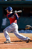 Eric Herman #12 of the Shippensburg Red Raiders follows through on his swing versus the Catawba Indians February 14, 2010 in Salisbury, North Carolina.  Photo by Brian Westerholt / Four Seam Images