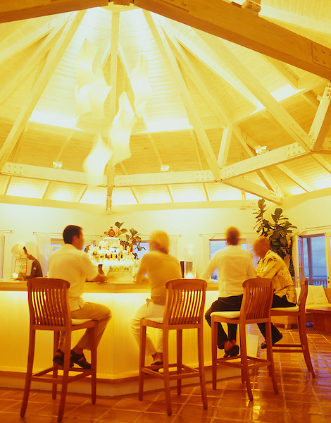 PARROT CAY, TURKS AND CAICOS : Guests have drinks at the Terrace Bar at Parrot Cay resort. Parrot Cay, Turks and Caicos.