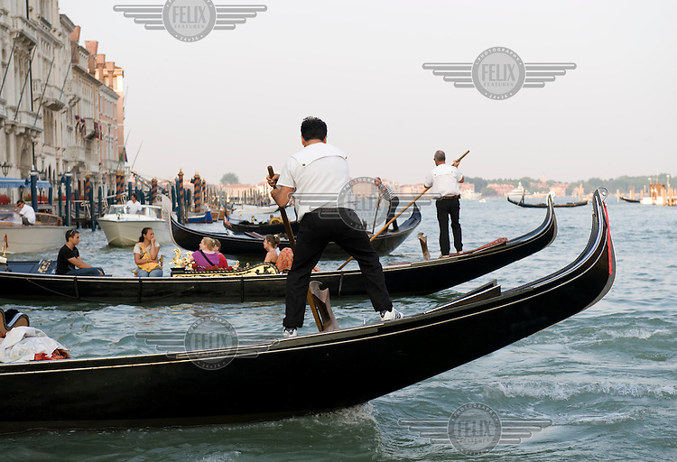 Gondolas on the Grand Canal in Venice. Otherwise known as Canalazzo, the Grand Canal is the main waterway which runs through the heart of the city.