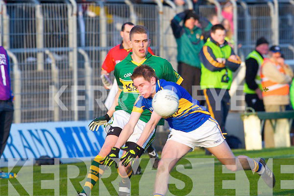 Kerry's Cillian Fitzgerald gets his pass in against Tipperary's Bill Maher in the Munster minor football championship at Austin Stack park, Tralee on Saturday.