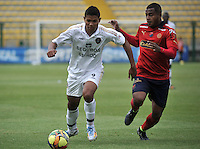 BOGOTA- COLOMBIA -06 -09-2014: Jorge Ramos (Izq.) jugador de Fortaleza FC disputa el balón con Jehrson Cordoba (Der.) jugador de Deportivo Independinete Medellin durante partido entre Fortaleza FC y Deportivo Independinete Medellin por la fecha 8 de la Liga Postobon II 2014, jugado en el Metropolitano de Techo de la ciudad de Bogota. / Jorge Ramos (L) player of Fortaleza FC vies for the ball with Jehrson Cordoba (R) player of Deportivo Independinete Medellin during a match between Fortaleza FC and Deportivo Independinete Medellin for the date 8th of the Liga Postobon II 2014 at the Metropolitano de Techo Stadium in Bogota city. / Photo: VizzorImage  / Luis Ramirez / Staff.