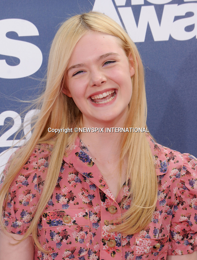 """ELLE FANNING.attends the 2011 MTV Movie Awards at the Gibson Amphitheatre on June 5, 2011 in Universal City, California.Mandatory Photo Credit: ©Crosby/Newspix International. .**ALL FEES PAYABLE TO: """"NEWSPIX INTERNATIONAL""""**..PHOTO CREDIT MANDATORY!!: NEWSPIX INTERNATIONAL(Failure to credit will incur a surcharge of 100% of reproduction fees)..IMMEDIATE CONFIRMATION OF USAGE REQUIRED:.Newspix International, 31 Chinnery Hill, Bishop's Stortford, ENGLAND CM23 3PS.Tel:+441279 324672  ; Fax: +441279656877.Mobile:  0777568 1153.e-mail: info@newspixinternational.co.uk"""