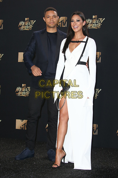 LOS ANGELES, CA - MAY 7: Trevor Noah and Jordyn Taylor at the 2017 MTV Movie and TV Awards at The Shrine Auditorium in Los Angeles, California on May 7, 2017. <br /> CAP/MPI/FS<br /> &copy;FS/MPI/Capital Pictures