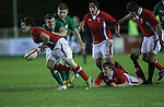 Wales scrum half Rhodri Williams spills the ball under pressure from Ireland flanker Ryan Murphy..Under 20 Six Nations.Wales v Ireland.Eirias - Colwyn Bay.01.02.13.©Steve Pope