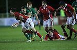 Wales scrum half Rhodri Williams spills the ball under pressure from Ireland flanker Ryan Murphy..Under 20 Six Nations.Wales v Ireland.Eirias - Colwyn Bay.01.02.13.©Steve Pope